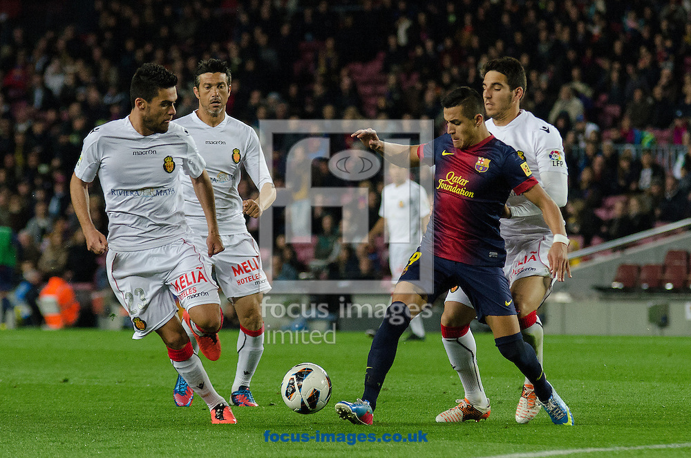 Picture by Cristian Trujillo/Focus Images Ltd +34 64958 5571.06/04/2013.Alexis Sánchez of FC Barcelona and Kevin, Martí and Bigas of Real Club Deportivo Mallorca during the La Liga match at Camp Nou, Barcelona.