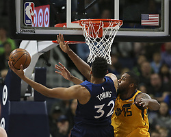 April 1, 2018 - Minneapolis, MN, USA - Minnesota Timberwolves center Karl-Anthony Towns (32) shoots while defended by Utah Jazz forward Derrick Favors (15) in the second quarter on Sunday, April 1, 2018 at Target Center in Minneapolis, Minn. (Credit Image: © Jeff Wheeler/TNS via ZUMA Wire)