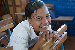 Central America, Nicaragua, Granada.  Teenage girl in classroom at school in Santa Ana de Malacos.  MR