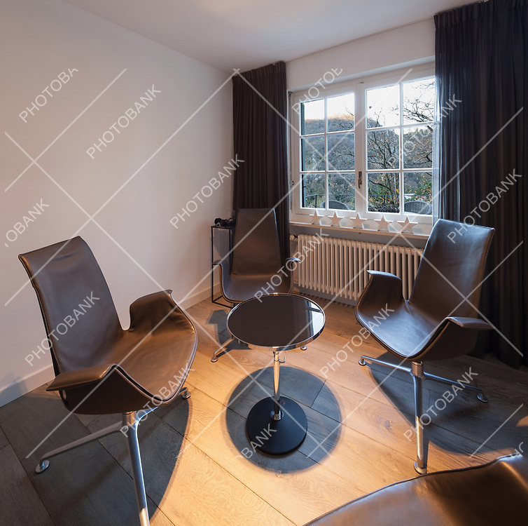 Interior, room with leather chairs and coffee table, parquet floor