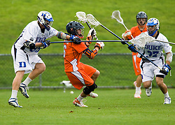 Virginia attackman Ben Rubeor (6) is checked by Duke defenseman Parker Mckee (35) and defenseman Mike Manley (37).  The #2 ranked Duke Blue Devils defeated the #3 ranked Virginia Cavaliers 11-9 in the finals of the Men's 2008 Atlantic Coast Conference tournament at the University of Virginia's Klockner Stadium in Charlottesville, VA on April 27, 2008.
