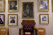 A wall of photos of former pastors in the basement of 16th Street Baptist Church on August 13, 2013 in downtown Birmingham, Alabama. In 1963, four girls were killed when a bomb under the church's side steps went off.
