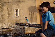 Boys play in Qsiba in Bizerte, Tunisia. Bizerte is the northernmost city in Africa.