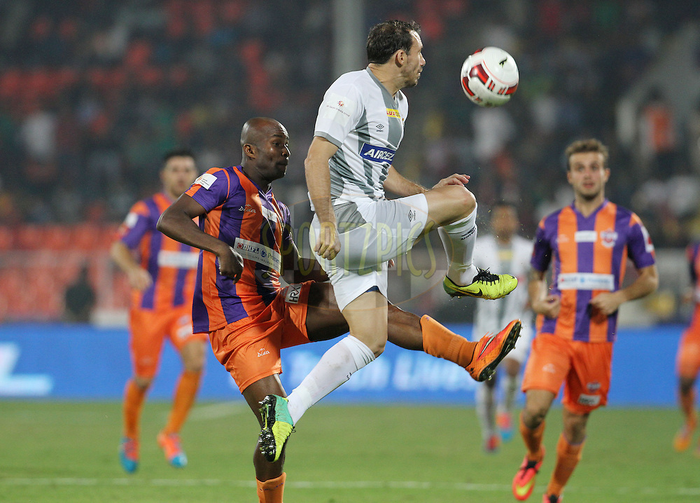 MacPherlin Dudu Omagbemi of FC Pune City and Jose Miguel Gonzalez Rey of Atletico de Kolkata in action during match 44 of the Hero Indian Super League between FC Pune City and Atletico de Kolkata FC held at the Shree Shiv Chhatrapati Sports Complex Stadium, Pune, India on the 29th November 2014.<br /> <br /> Photo by:  Vipin Pawar/ ISL/ SPORTZPICS