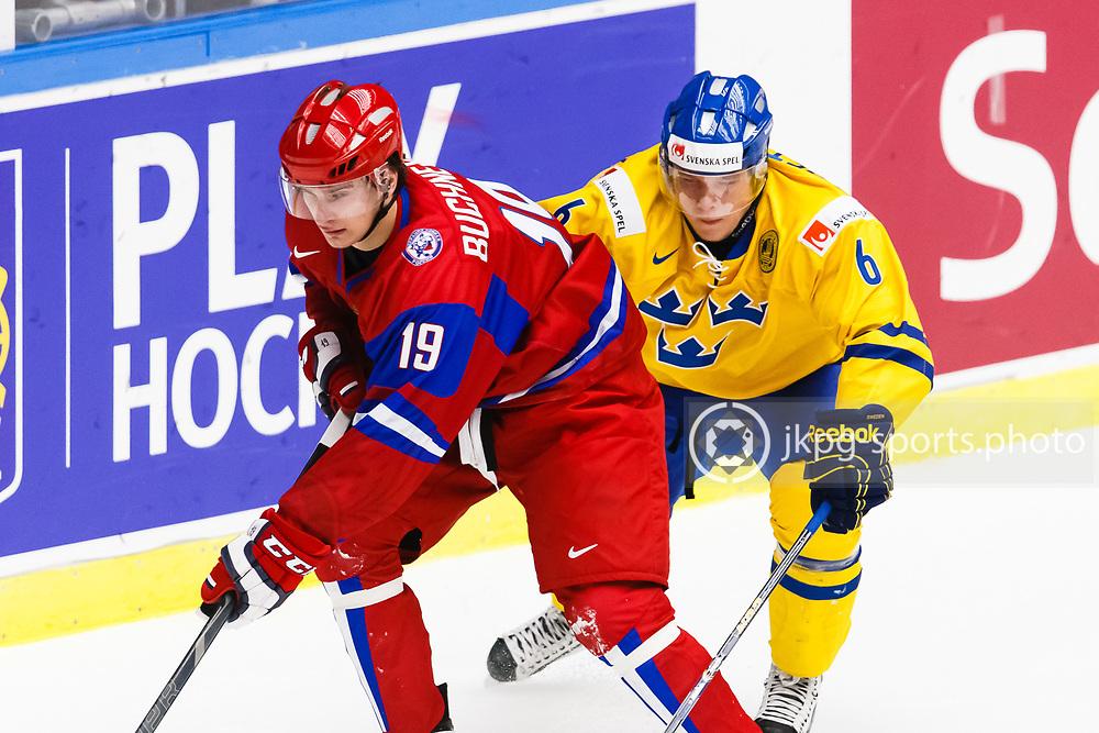 140104 Ishockey, JVM, Semifinal,  Sverige - Ryssland<br /> Icehockey, Junior World Cup, SF, Sweden - Russia.<br /> Pavel Buchnevich, (RUS), Jesper Pettersson, (SWE).<br /> Endast f&ouml;r redaktionellt bruk.<br /> Editorial use only.<br /> &copy; Daniel Malmberg/Jkpg sports photo