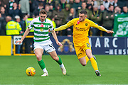 James Forrest (#49) of Celtic FC shields the ball from Jack McMillan (#21) of Livingston FC during the Ladbrokes Scottish Premiership match between Livingston FC and Celtic FC at The Tony Macaroni Arena, Livingston, Scotland on 6 October 2019.