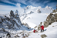 A male mountaineer assists his partner during a rapid ascent of easy snow couloir of Aiguilles Marbrées.