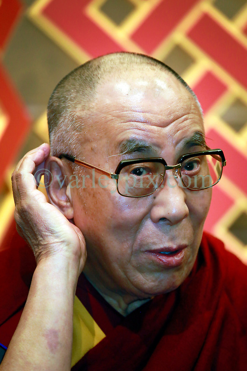 17 May 2013. New Orleans, Louisiana,  USA. .His Holiness the 14th Dalai Lama in New Orleans for the 'Resiliance - Strength through Compassion and Connection' conference. The Dalai lama cups his ear to better hear a question from the press..Photo; Charlie Varley.