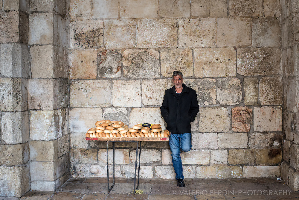 A man sells fresh bread at Jaffa Gate, one of the entrances of the Jerusalem Old CIty walls.