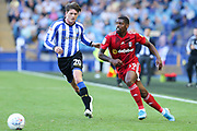 Fulham forward Ivan Cavaleiro (19) and Sheffield Wednesday midfielder Adam Reach (20) during the EFL Sky Bet Championship match between Sheffield Wednesday and Fulham at Hillsborough, Sheffield, England on 21 September 2019.