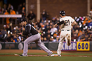 San Francisco Giants third baseman Conor Gillaspie (21) is tagged out at first base after making a hit against the Colorado Rockies at AT&T Park in San Francisco, Calif., on September 27, 2016. (Stan Olszewski/Special to S.F. Examiner)