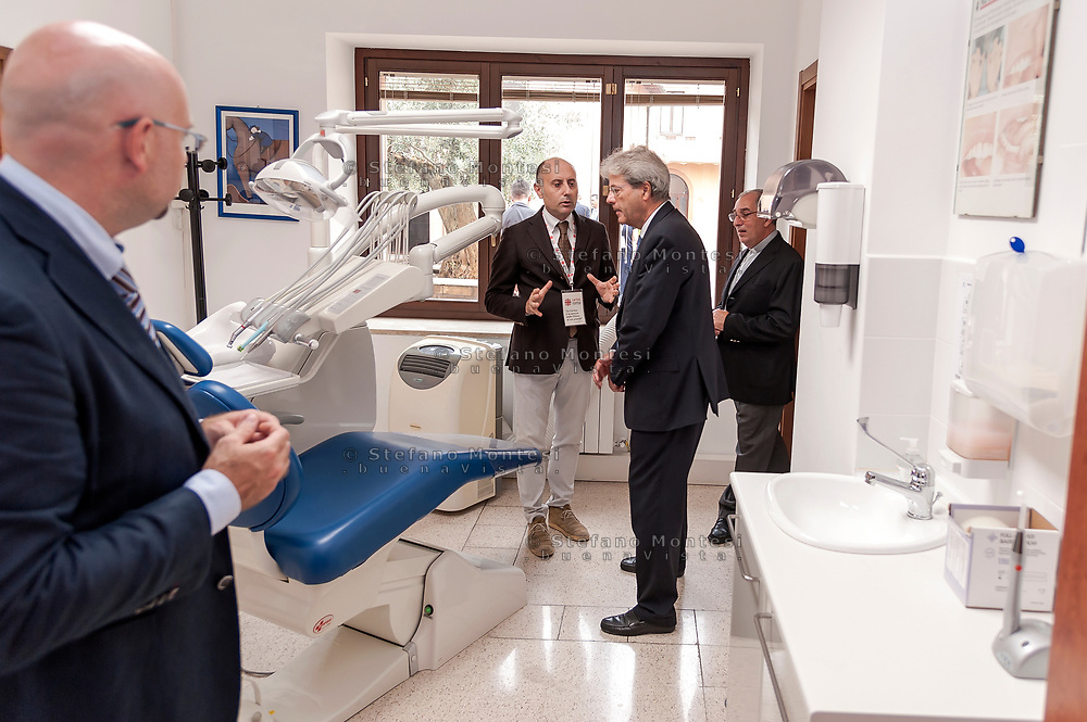 ROME, ITALY - SEPTEMBER 01: Italian PM Paolo Gentiloni visit dental centre during visit the Citadel of the Charity of the Diocesan Caritas of Rome on September 1, 2017 in Rome, Italy. Italian PM Paolo Gentiloni visited the Caritas to express the gratitude of all Italians to the world of volunteering, to those who work in favour of solidarity