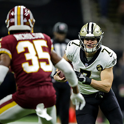 Oct 8, 2018; New Orleans, LA, USA New Orleans Saints specialist Taysom Hill (7) runs as Washington Redskins safety Montae Nicholson (35) pursues during the fourth quarter at the Mercedes-Benz Superdome. The Saints defeated the Redskins 43-19.