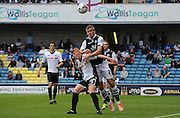 Steve Morrison leaping highest to win the header during the Sky Bet League 1 match between Millwall and Rochdale at The Den, London, England on 26 September 2015. Photo by Michael Hulf.