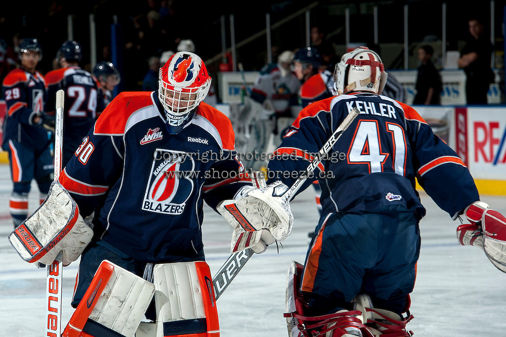 KELOWNA, CANADA -FEBRUARY 1: Cole Kehler G #41 and Bolton Pouliot G #30 of the Kamloops Blazers change places in net during warm up against the Kelowna Rockets on February 1, 2014 at Prospera Place in Kelowna, British Columbia, Canada.   (Photo by Marissa Baecker/Getty Images)  *** Local Caption *** Cole Kehler; Bolton Pouliot;