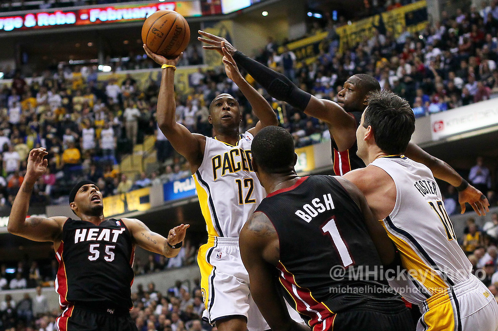 Feb. 15, 2011; Indianapolis, IN, USA; Indiana Pacers guard AJ Price (12) shoots against the Miami Heat at Conseco Fieldhouse. Miami defeated Indiana 110-103. Mandatory credit: Michael Hickey-US PRESSWIRE