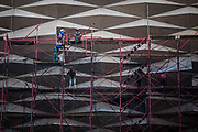 Contruction worker repair the part of the building at Thamrin street, central Jakarta on June 22, 2015