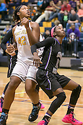 Cedar Ridge's Lashann Higgs backs up Stony Point's Jordan Moore Friday at Stony Point Gym.  The Raiders rolled the Tigers 75-37.  (LOURDES M SHOAF for Round Rock Leader.)