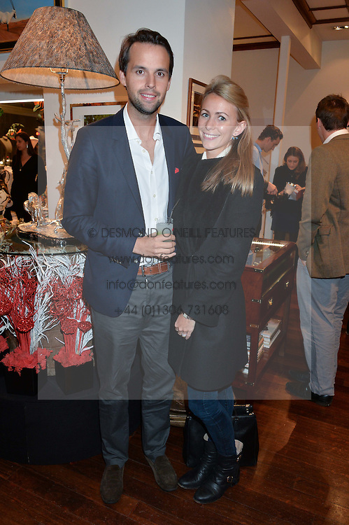 CHARLIE & ANNEKE GILKES at a pre christmas party & shopping evening at Patrick Mavros, 104-106 Fulham Road, London on 26th November 2014.
