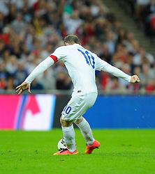 England captain, Wayne Rooney (Manchester United) scores his penalty - Photo mandatory by-line: Joe Meredith/JMP - Mobile: 07966 386802 - 3/09/14 - SPORT - FOOTBALL - London - Wembley Stadium - England v Norway - International Friendly