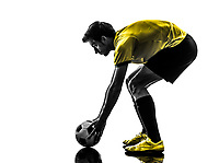 one Brazilian soccer football player young man preparing free kick in silhouette studio on white background