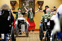 Mary Ann Souza, center, Cathy Shadle, right, and Maria Caprile with the Northwest Hula dance group, perform for residents at Life Care Center of Post Falls during a program Monday celebrating National Nursing Home Week.