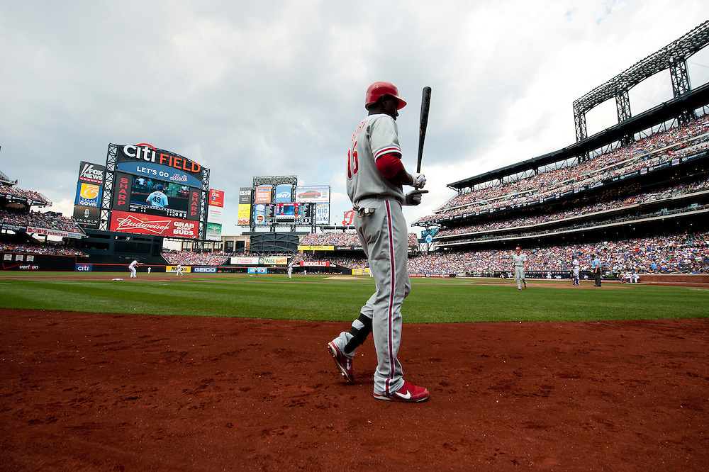 NEW YORK - JULY 16: John Mayberry Jr. #15 of the Philadelphia Phillies walks onto the field before his up at bat against the New York Mets at Citi Field on July 16, 2011 in the Queens borough of Manhattan. (Photo by Rob Tringali) *** Local Caption *** John Mayberry Jr.