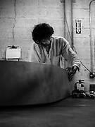 Photographic documentation of artist/craftsman Maciej Markowicz's Leaning Piano functional modern sculpture.