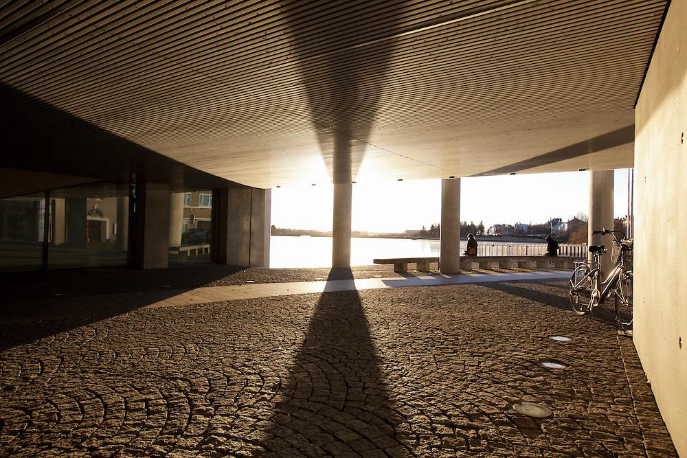 The sun under Reykjavik City Hall