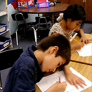 Elementary classroom scene, Hispanic American students taking a text