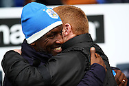 Huddersfield Town Manager Chris Powell and Bolton Wanderers Manager Neil Lennon embrace prior to kick off. Skybet football league championship match, Bolton Wanderers v Huddersfield Town at the Macron stadium in Bolton, Lancs on Saturday 29th November 2014.<br /> pic by Chris Stading, Andrew Orchard sports photography.