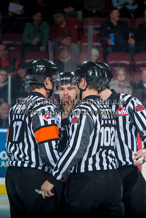 KELOWNA, CANADA - MARCH 7: Referees Nick Panter and Steve Papp with linesmen Dustin Minty and Tim Plamondon take part in a pre-game ritual at the Kelowna Rockets against the Vancouver Giants  on March 7, 2018 at Prospera Place in Kelowna, British Columbia, Canada.  (Photo by Marissa Baecker/Shoot the Breeze)  *** Local Caption ***