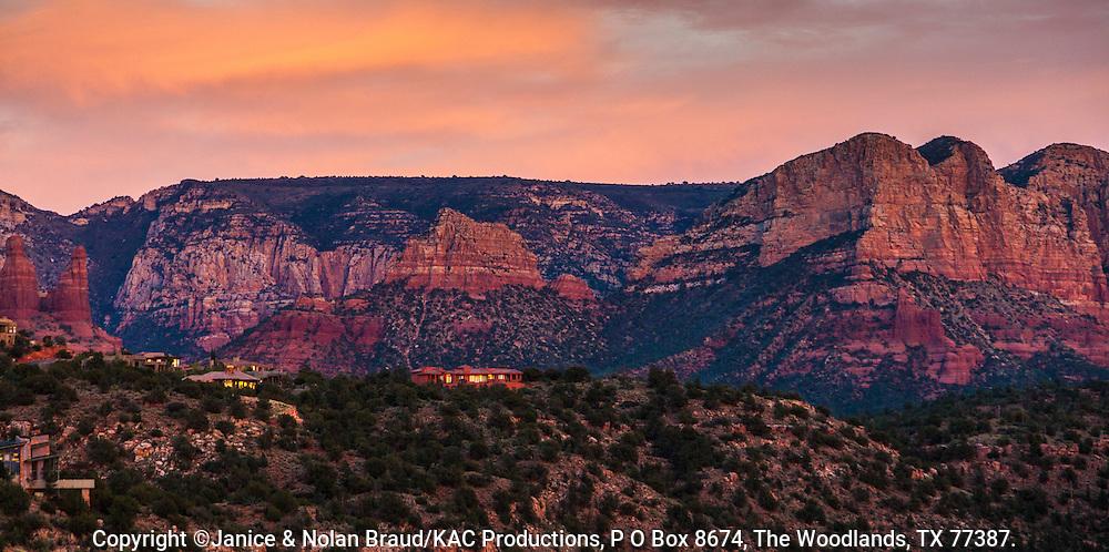 Sunset light is very dramatic on red sandstone rock hills around Sedona, Arizona.
