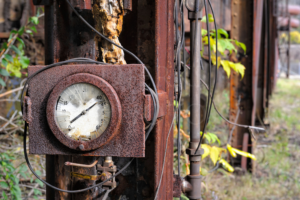 A broken industrial gauge that failed the final stress test, smashed and abandoned outside at Carrie Furnace near Pittsburgh, PA.