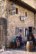 Locals at a traditional bar in cobbled street of Calle Del Canton in Santillana del Mar, Northern Spain