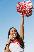 Cheerleader Using Cell Phone