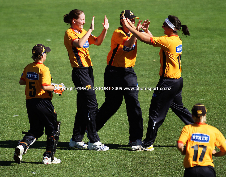 Wellington bowler Amanda Cooper and captain Anna Dodd congratulate Kerry-Anne Tomlinson for catching Janet Brehaut.<br /> State League final. Wellington Blaze v Canterbury Magicians at Allied Prime Basin Reserve, Wellington. Saturday, 24 January 2009. Photo: Dave Lintott/PHOTOSPORT