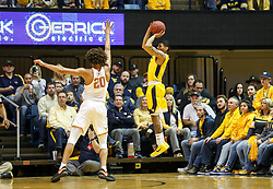 Jan 20, 2018; Morgantown, WV, USA; West Virginia Mountaineers guard James Bolden (3) shoots a three pointer during the first half against the Texas Longhorns at WVU Coliseum. Mandatory Credit: Ben Queen-USA TODAY Sports