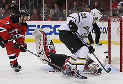 Oct 8; Newark, NJ, USA; Dallas Stars left wing Loui Eriksson (21) scores on a rebound over New Jersey Devils goaltender Martin Brodeur (30) during the second period at the Prudential Center.
