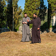 Serbian Orthodox monks, Hektarios (L) and Constantine, discuss monastery matters during a walk through its cemetery grounds.  Zitomislic monastery near Mostar, Bosnia and Herzegovina.