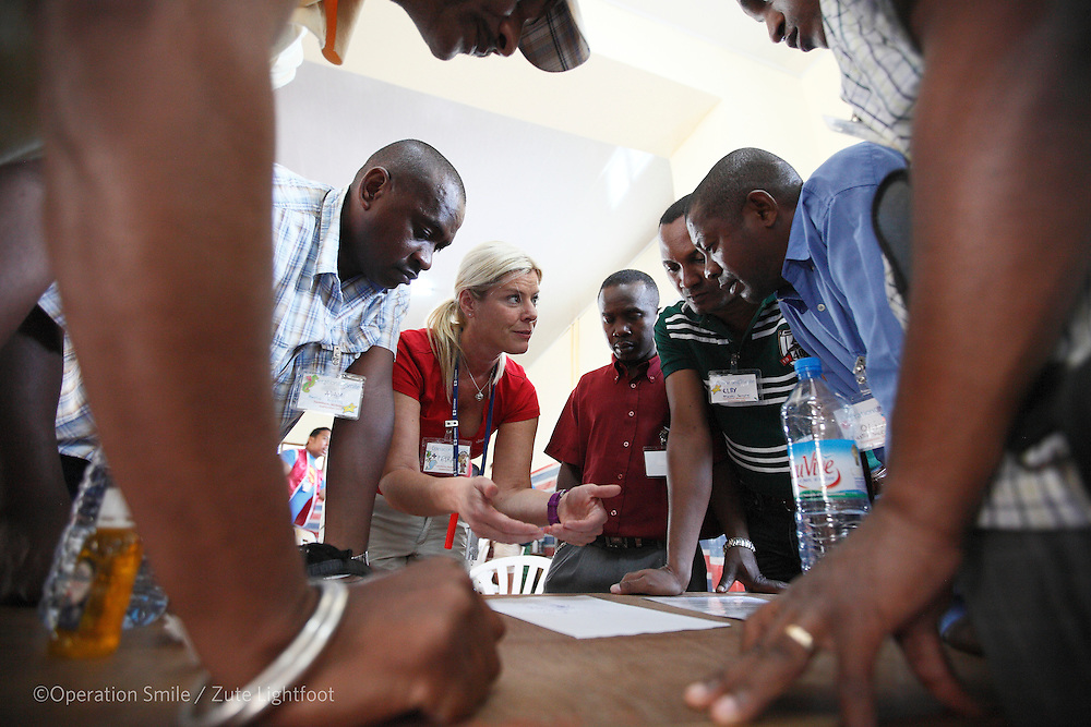 Plastic Surgeon Petra Peterson from Sweden with team of Madagascan surgeons during screening during Operations Smile's 2015 mission to Tamatave at Tamatave General Hospital. Antsirabe Clinic Project sponsored by the Swedish Postal Code lottery. Madagascar. September 2015.<br /> (Operation Smile Photographer &ndash; Zute Lightfoot)