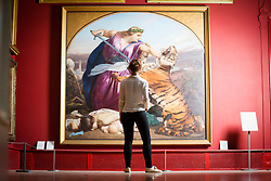 © Licensed to London News Pictures. 12/10/2017. Leeds UK. Phoebe Moore looks at Edward Armitage's 1858 painting 'Retribution' that has been re-hung in time for the Leeds Art Gallery reopening tomorrow (friday 13th Oct) after an 18month renovation costing £4.5M  with new acquisitions & rehanging of the extensive collection. Founded in 1888, Leeds Art Gallery has designated collection of 19th & 20th century British painting & sculpture widely considered to be the best outside the national collections. Photo credit: Andrew McCaren/LNP