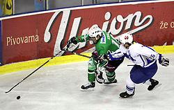 Jure Kralj of Olimpija and Luka Novosel of Medvescak at 3rd round of Slovenian Ice-Hockey National Championships semi-final match between HD Tilia Olimpija, Ljubljana and Medvescak Zagreb, Croatia, on March 11, 2009, in Hala Tivoli, Ljubljana, Slovenia. (Photo by Vid Ponikvar / Sportida)