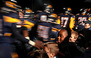 11 Nov. 2011 -- O'FALLON, Ill. -- Youth football players from O'Fallon Township welcome the O'Fallon Township High School football team onto the field during player introductions before the Panthers' game with Chicago's St. Rita High School during the IHSA Class 7A playoff football game at O'Fallon Township High School in O'Fallon, Ill. Friday, Nov. 11, 2011. Photo © copyright 2011 Sid Hastings.