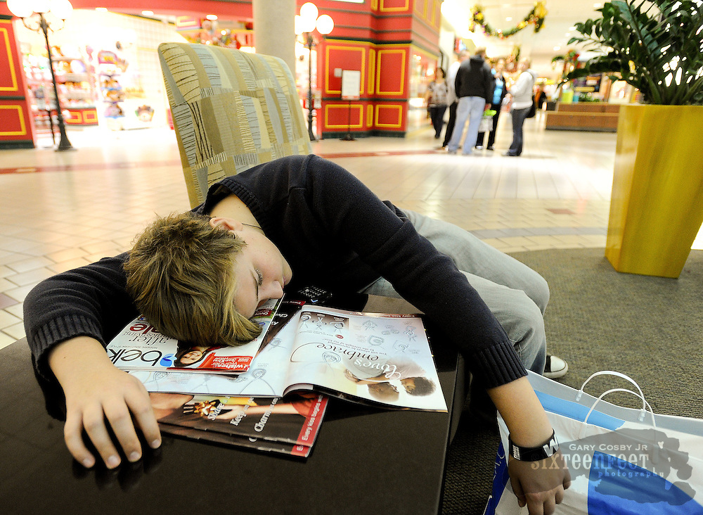Photo by Gary Cosby Jr.        Shoppers hit area stores before sunrise Friday morning for the Black Friday sales events.  Branson Norris takes a rest at 5:42 a.m. in the Decatur Mall.  He had been out shopping with his family since 1 a.m.