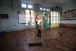 © Licensed to London News Pictures. 28/12/2015. Mytholmroyd UK. Picture shows teacher Mrs Walker in her class room at Burnley Road Academy in Mytholmroyd that has been devastated by flooding, loosing almost everything when the entire ground floor of the primary school flooded. Photo credit: Andrew McCaren/LNP