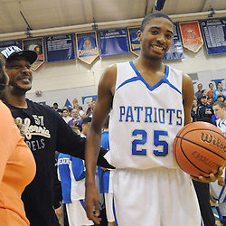 Staff photos by Tom Kelly IV<br /> Bridges celebrates with his parents Tyneeha Rivers and Jack Devine following his 1000th point.  Great Valley senior Mikal Bridges (25) scored his 1000th point Friday night December 20, 2013 in a home game against Archbishop Wood.