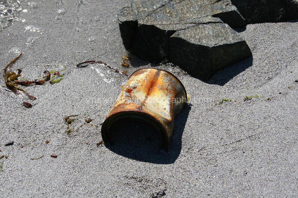 Rusty can on beach