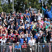 Ryder Cup 2016. Spectators in the stands on the sixth hole react to Rory McIlory of Europe's approach shot which went straight into the hole during practice day at the Hazeltine National Golf Club on September 29, 2016 in Chaska, Minnesota.  (Photo by Tim Clayton/Corbis via Getty Images)