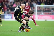 Morecambe Midfielder Kevin Ellison tussles with Northampton Town Striker Ricky Holmes during the Sky Bet League 2 match between Northampton Town and Morecambe at Sixfields Stadium, Northampton, England on 23 January 2016. Photo by Dennis Goodwin.